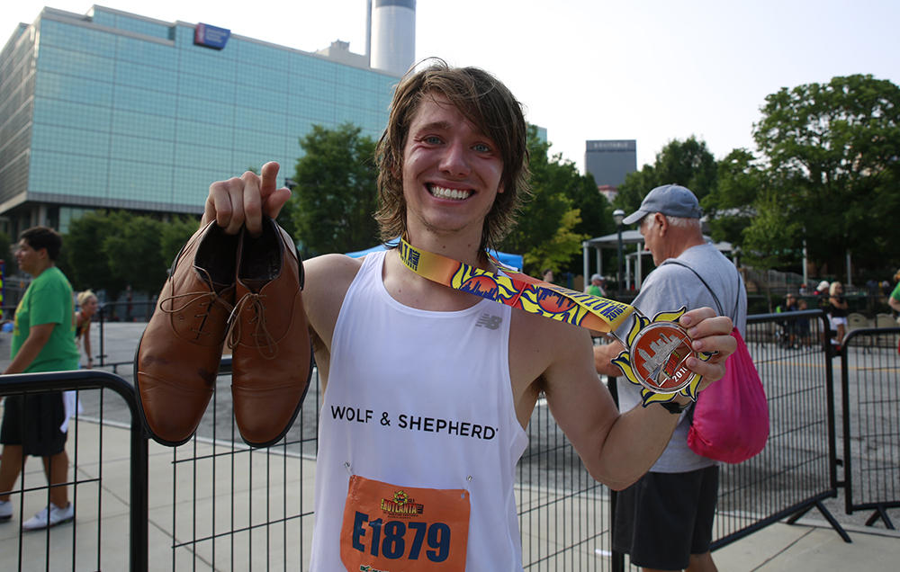 JURIS SILENIEKS SET A PENDING GUINNESS WORLD RECORD JUNE 12 FOR THE FASTEST HALF MARATHON IN DRESS SHOES